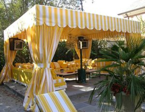 Commercial cabana with white and yellow striped awning fabric