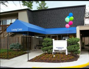 Blue awning fabric on a commercial entrance awning