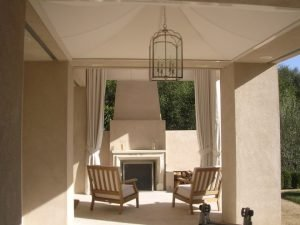 White drapes for an outdoor seating area