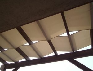 Dark trellis cover with tan awning fabric