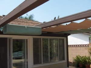 Green and gold retracted slide on wire awning