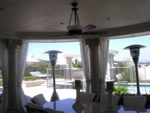 Custom white drapes for a pool area