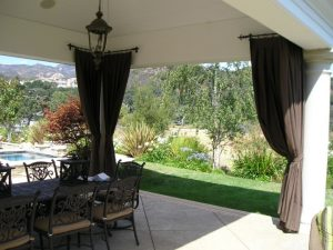 Brown custom drapes for a pool area