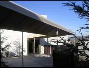 White awning fabric on a custom entrance awning