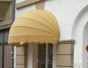 Residential awning with yellow awning fabric