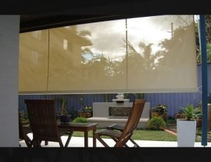 Residential drop-roll awning shade cover with yellow awning fabric