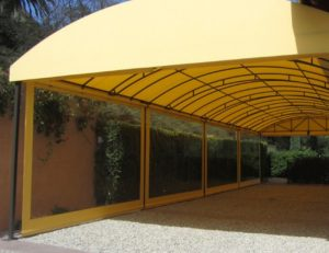 Custom awning with yellow awning fabric and drop-roll cover