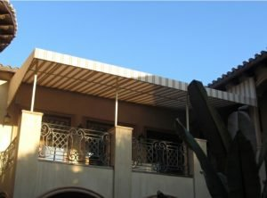 Custom patio shade awning with striped white and tan awning fabric