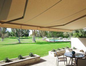 Dark tan awning fabric on a custom retractable awning