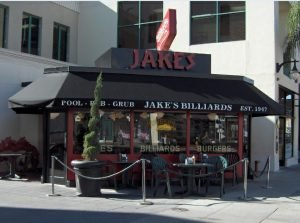 Black and red storefront awning for Jake's Billiards