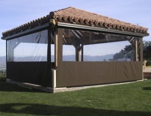 Cabana with brown drop-roll awning