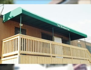 Commercial patio shade awning with green awning fabric for Toll Brothers Inc