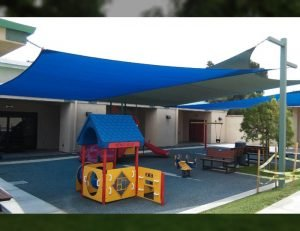 Blue sun shade panels for an outdoor playground