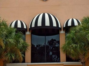 Commercial dome awning with black and white awning fabric
