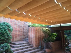 Tan residential slide on wire awning