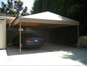 Custom residential carport awning with tan awning fabric