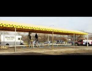 Yellow and black polka dot awning fabric on a custom carport awning