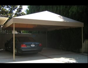 Residential carport awning with tan awning fabric