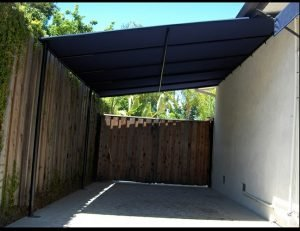 Blue carport awning on the side of a home