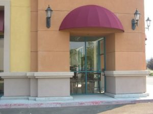 Commercial dome awning with red awning fabric