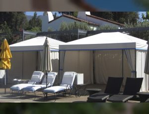 Residential cabanas with white and blue awning fabric