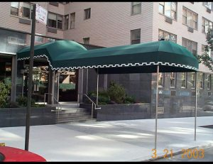 Green and white awning fabric on a custom walkway awning