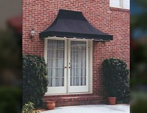 Backyard residential entrance awning with black awning fabric