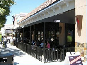 Black storefront awning with black beams for a restaurant patio