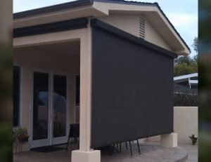 Residential drop-roll cover for a porch