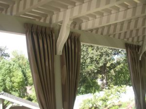 Brown drapes for a residential awning