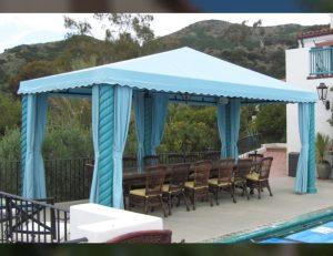Pool cabana with light blue awning fabric