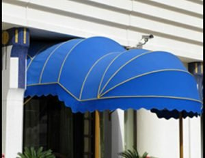 Blue and gold awning fabric on a custom entrance awning