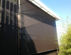 Brown drop-roll awning shade cover