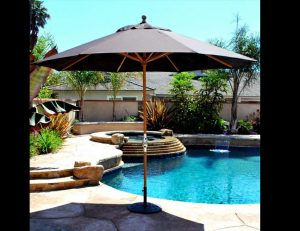 Grey residential umbrella for a pool area