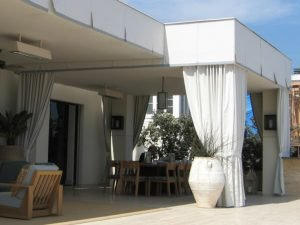 Custom white drapes for an outdoor area