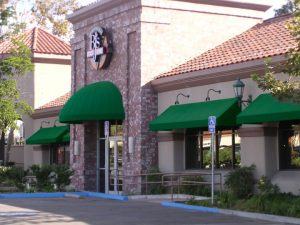 Commercial dome awnings and window awnings with green fabric for BJ's Restaurant