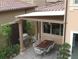 Residential trellis cover with white awning fabric