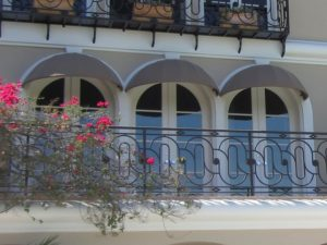 Dark grey dome awnings for a balcony