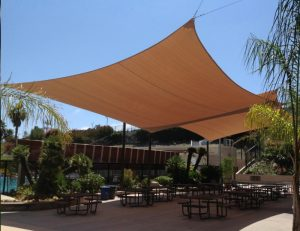 Brown commercial sun shade panels for an outdoor patio