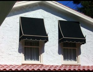 Black and gold residential window awnings with spearhead iron rods