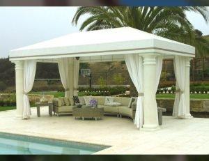Custom cabana with white awning fabric and white drapes