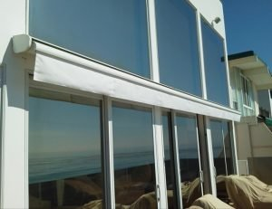 Residential retractable awning with white awning fabric