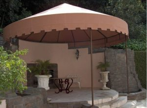 Patio shade awning with rust colored awning fabric