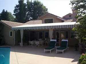 Patio shade awning with grey and white striped awning fabric