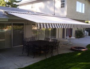 Custom patio retractable awning with multicolored awning fabric