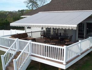 Large retractable awning with striped awning fabric