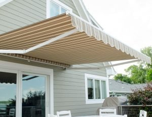 Striped awning fabric on a custom retractable awning