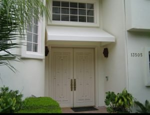Residential entrance awning with white awning fabric
