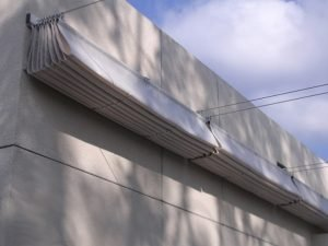 White retracted slide on wire awning