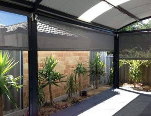 Drop-roll awning cover with grey awning fabric